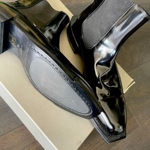 Alexander McQueen black leather ankle boots.